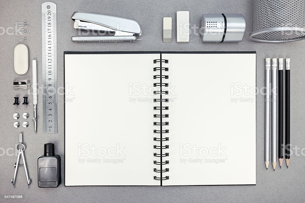 gray workplace with blank notebook and drawing tools stock photo