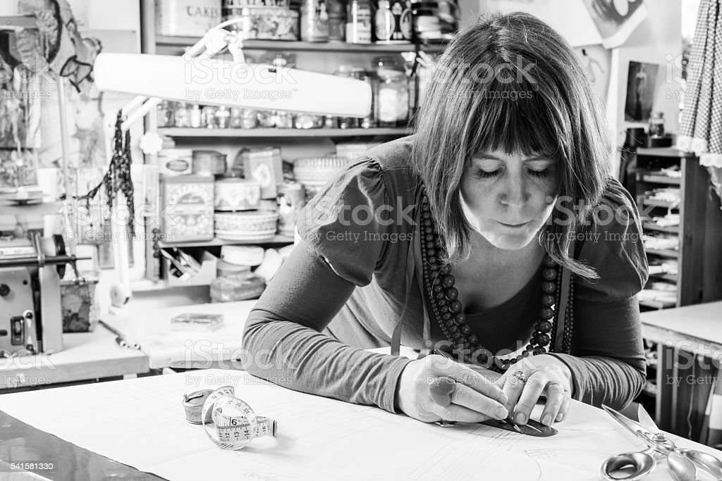 Grayscale Image of Seamstress Measuring Paper stock photo