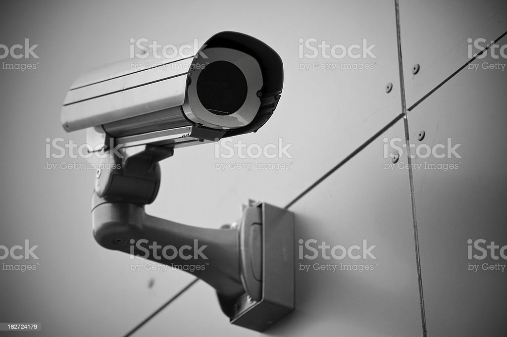 Grayscale image of security camera royalty-free stock photo