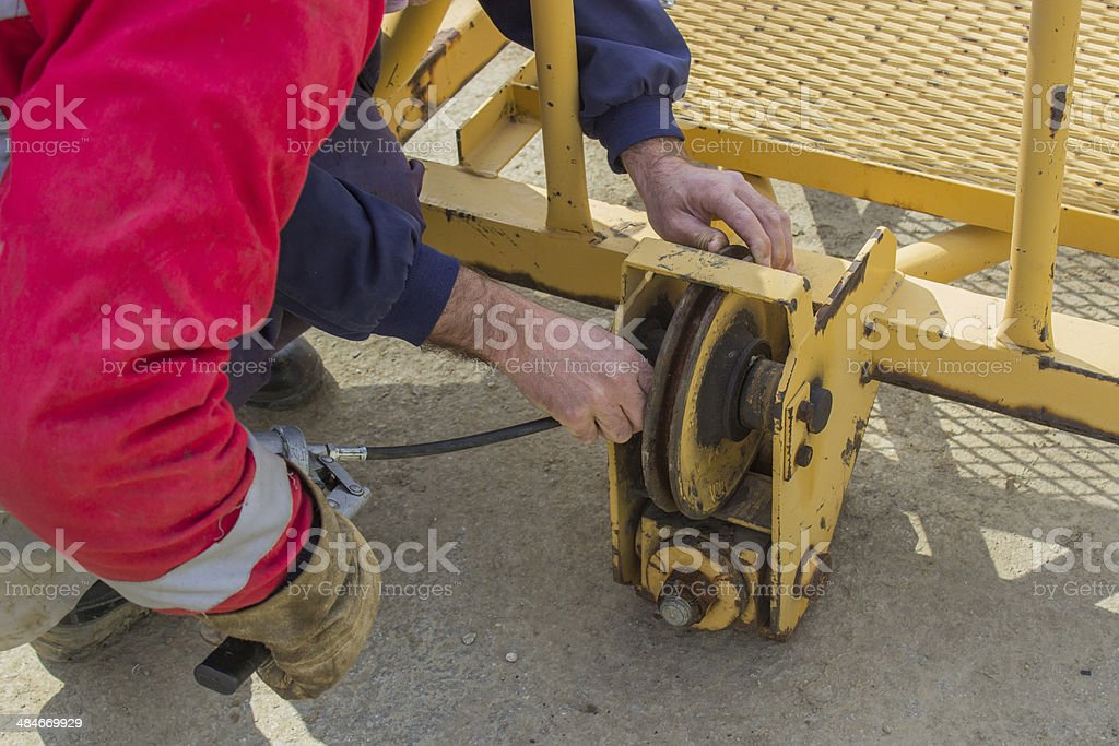 greasing parts of the crane stock photo