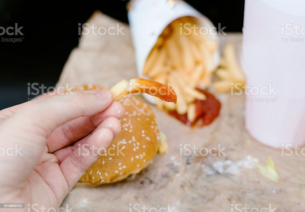 greasy fast food meal with burger and fries stock photo