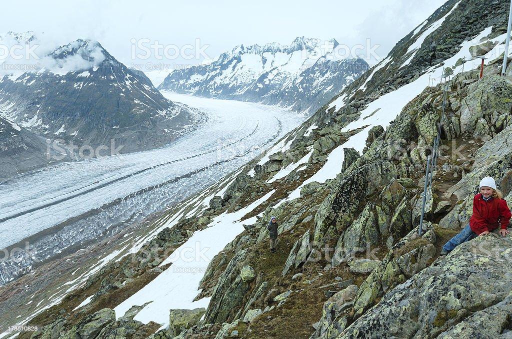 Great Aletsch Glacier (Bettmerhorn, Switzerland) and children. stock photo