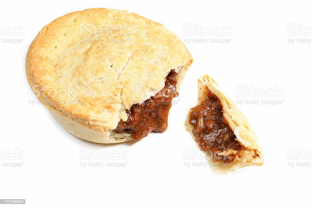 A great Aussie pie lunch with golden pastry royalty-free stock photo