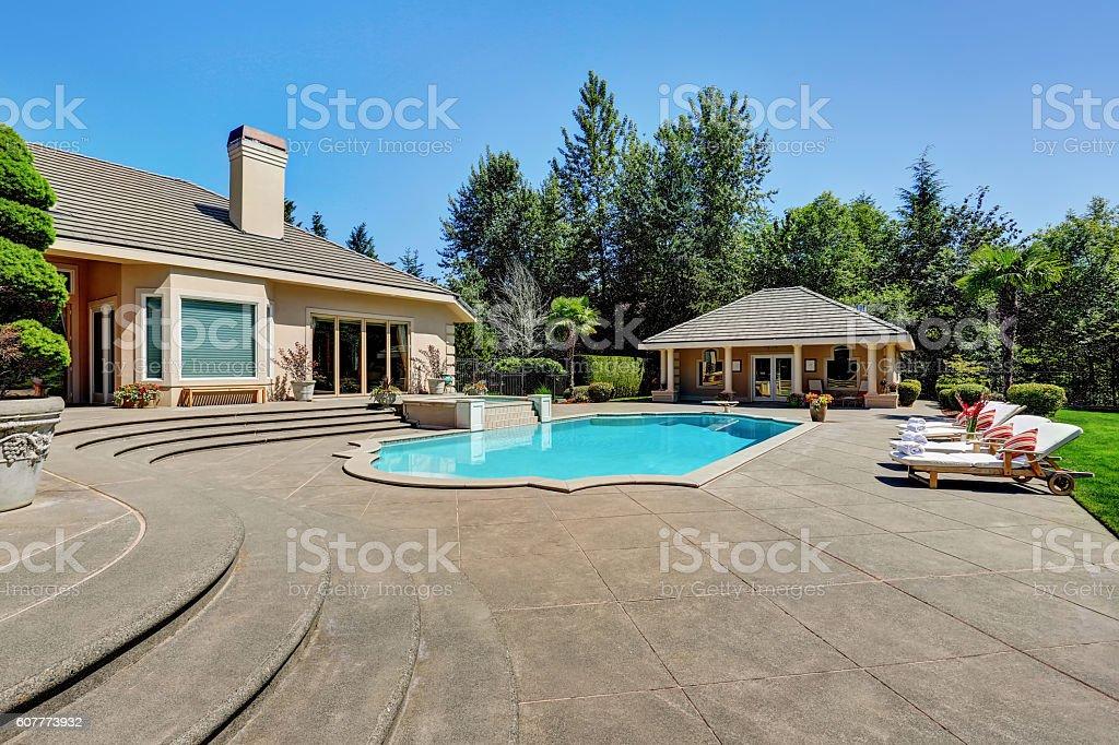 Great backyard with swimming pool in American Suburban luxury house stock photo