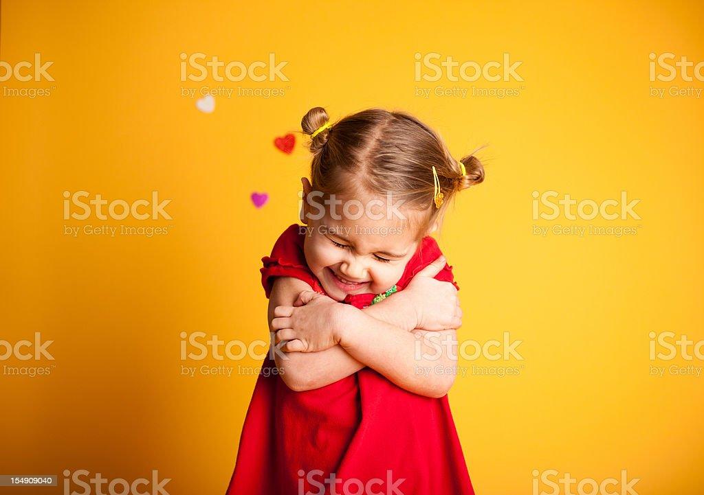 Great Big Valentine Hug, Cute Girl Hugging Herself stock photo