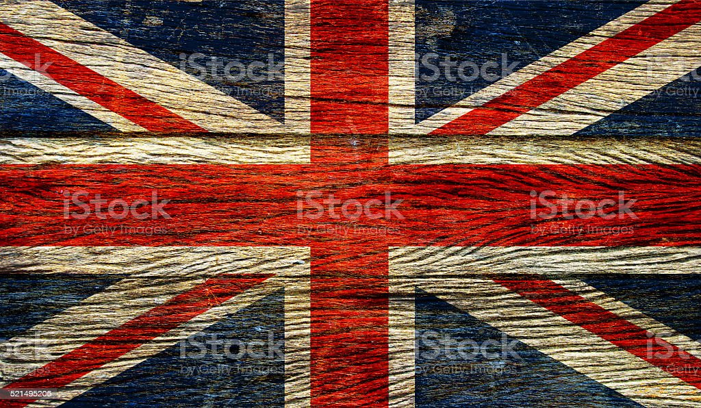 Great britain flag  on old wood background stock photo