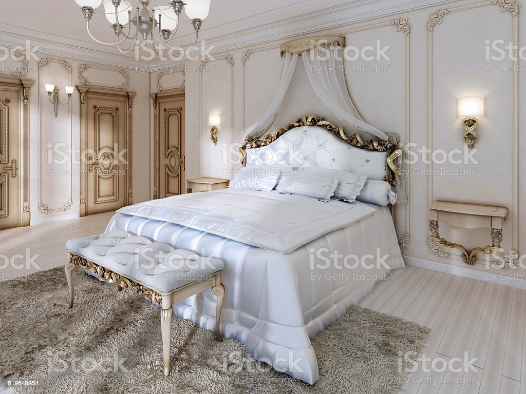 Great classic four-poster bed and soft white Comforter with pill stock photo
