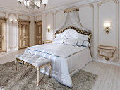 Great classic four-poster bed and soft white Comforter with pill