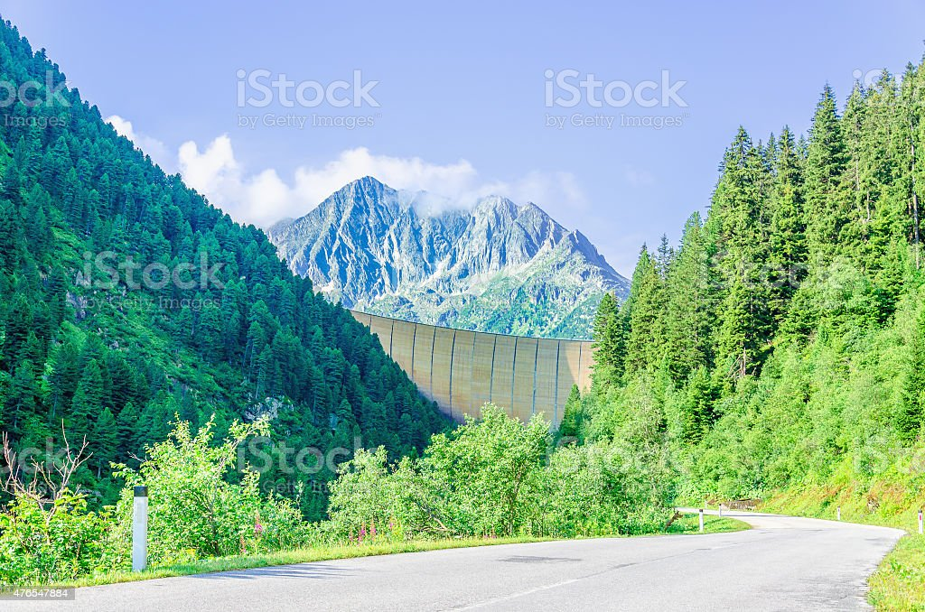 Great dam and high peaks of the Alps, Austria stock photo