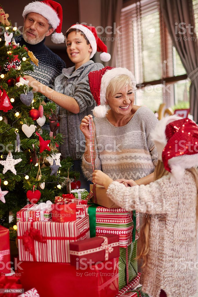 Great fun with dressing a Christmas tree stock photo