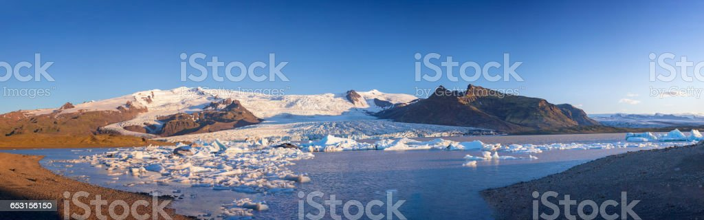 Great glacier lagoon in Iceland - Fjallsarlon at blue sky stock photo