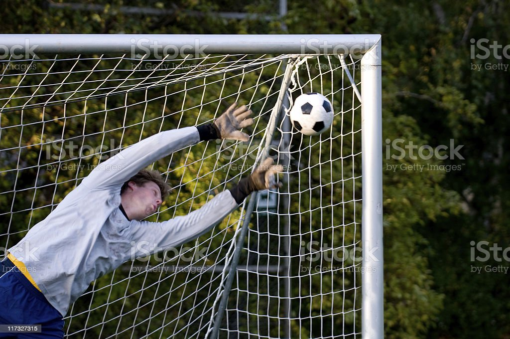 Great goal and the goalkeeper cannot block the ball stock photo