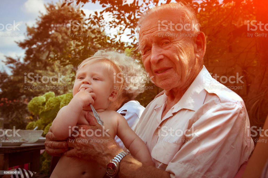 Great grandfather with baby stock photo