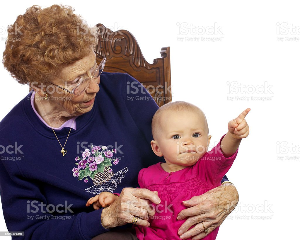 Great grandma with grand daughter enjoying each other royalty-free stock photo