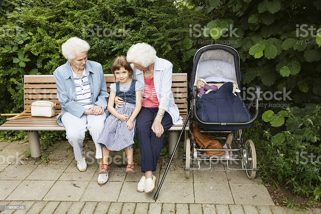 great grandmother and granddaughter family in park togetherness royalty-free stock photo