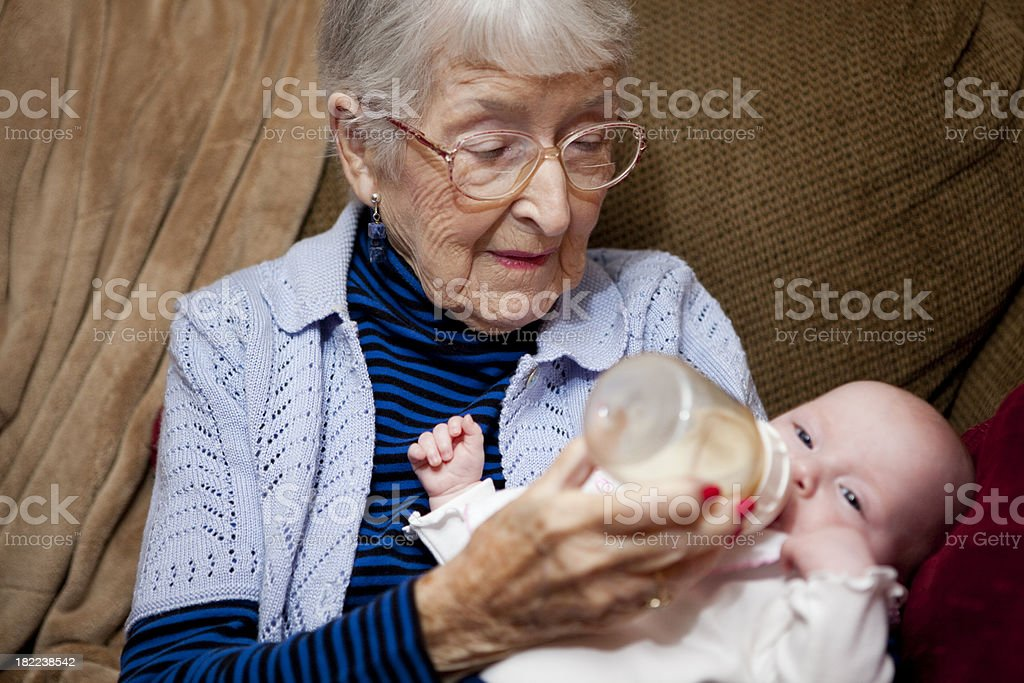 Great Grandmother and infant grand daughter, family stock photo