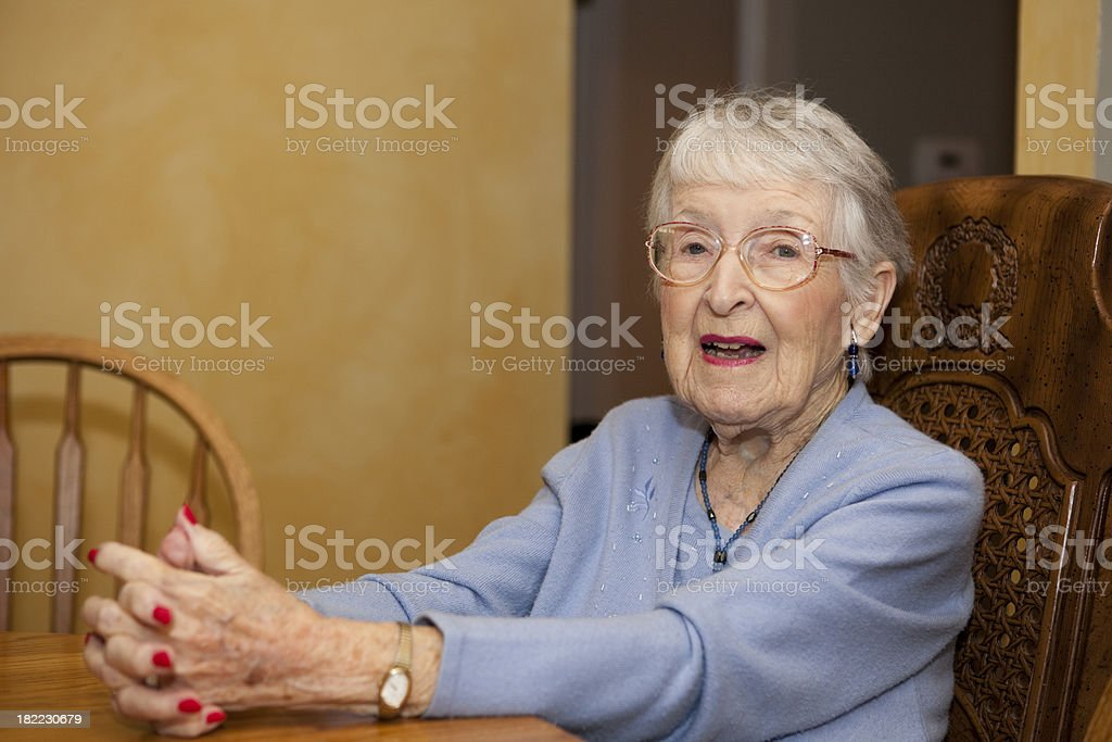 Great Grandmother at the dinner table, talking and discussing stock photo