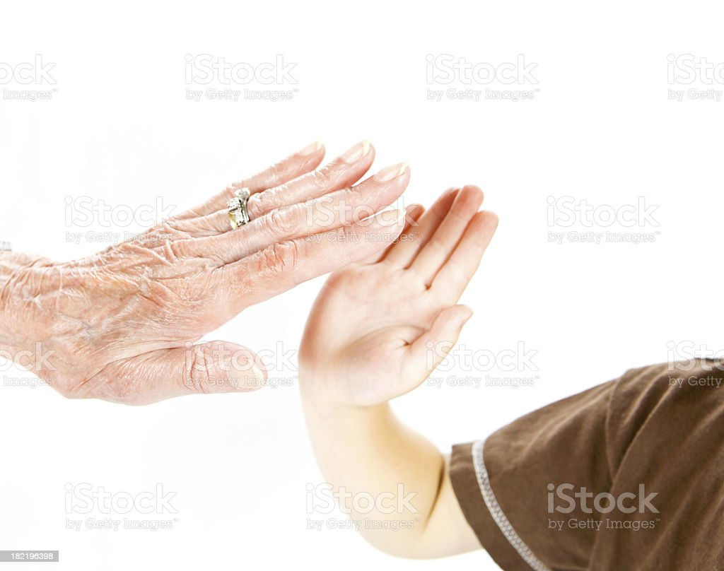 Great Grandmother High-Fiving Four Year Old Grandson royalty-free stock photo