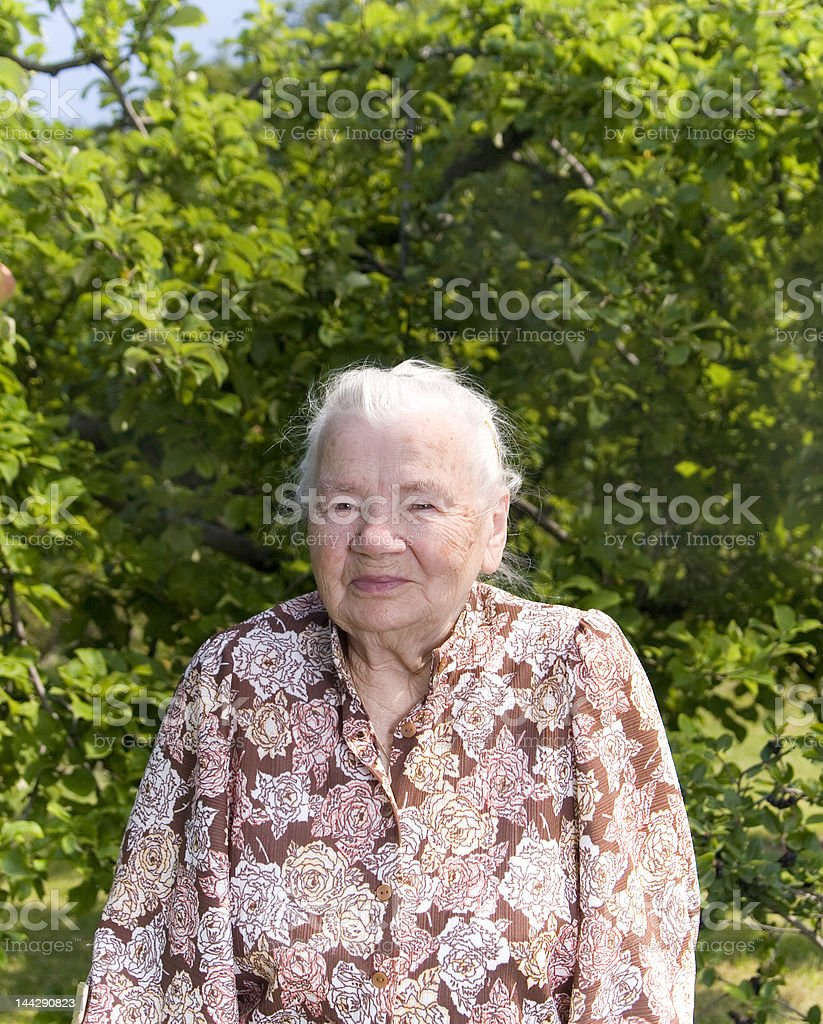 Great Grandmother in the garden royalty-free stock photo