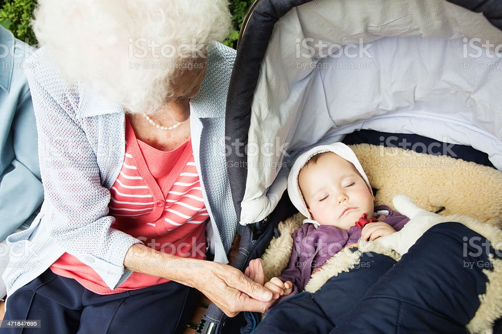 great grandmother senior woman with baby togetherness royalty-free stock photo