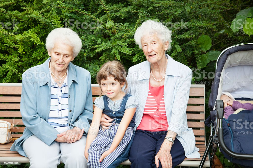 great grandmother, sister with  girl stock photo