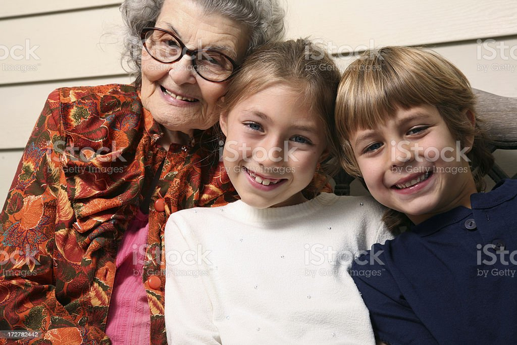 Great Grandmother sitting on Porch with Grandchildren royalty-free stock photo