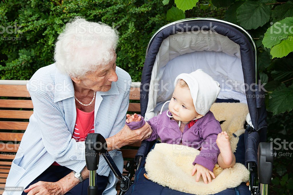 great grandmother with baby girl stock photo