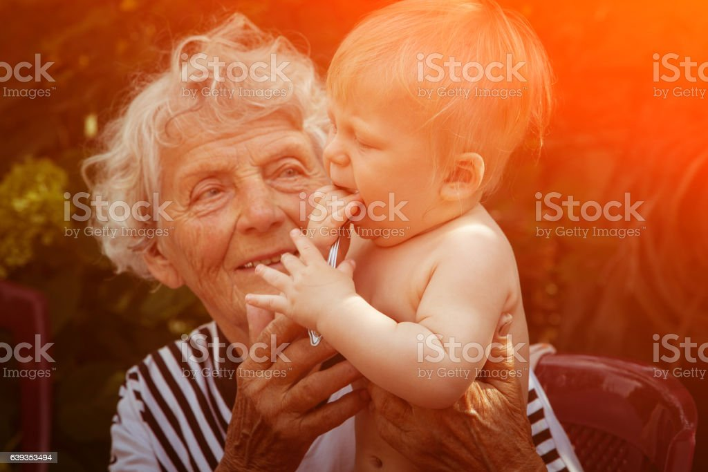 Great Grandmother with baby stock photo