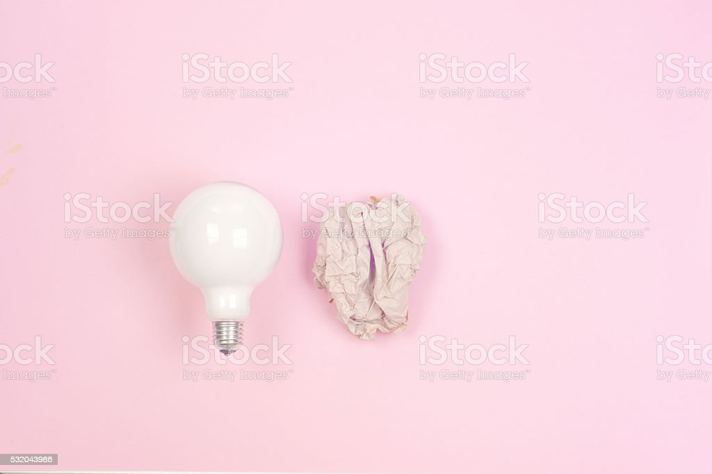 great idea concept with crumpled colorful paper and light bulb stock photo
