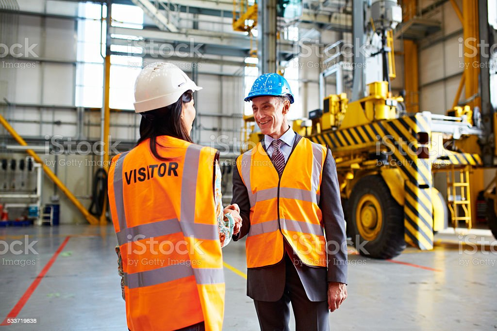 Great job on clearing the warehouse floor! stock photo
