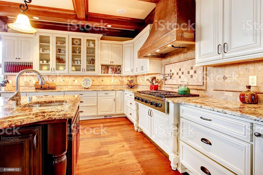 Great kitchen with nice hardwood floor and brilliant lighting.