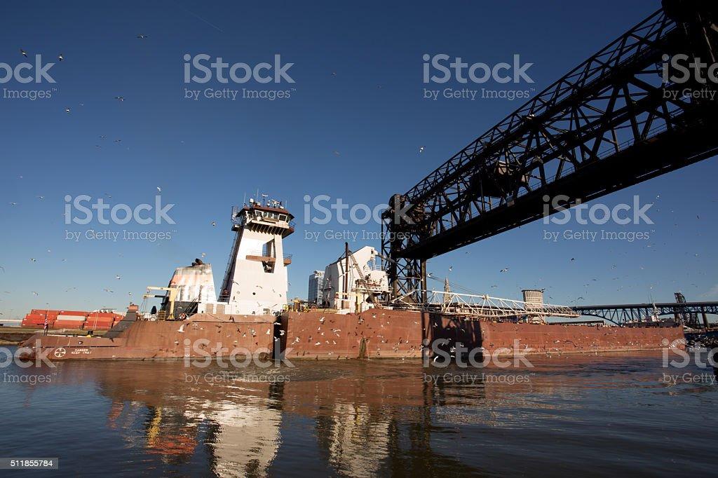 Great Lakes Freighter Passing Under Cuyahoga River Drawbridge stock photo