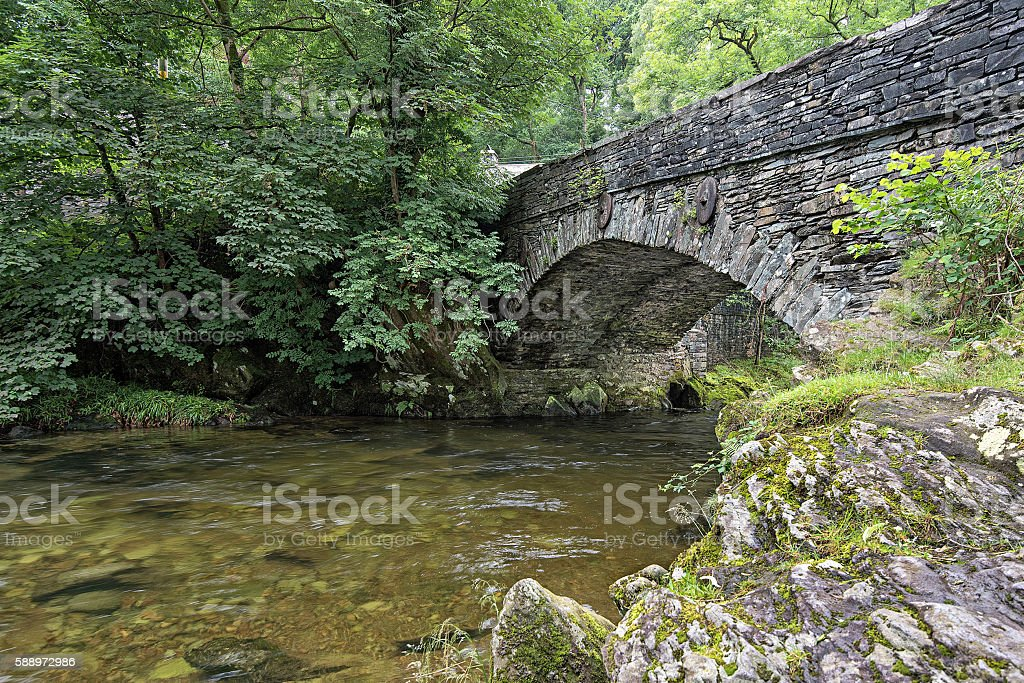 Great Langdale Beck flows under Elterwater Bridge stock photo