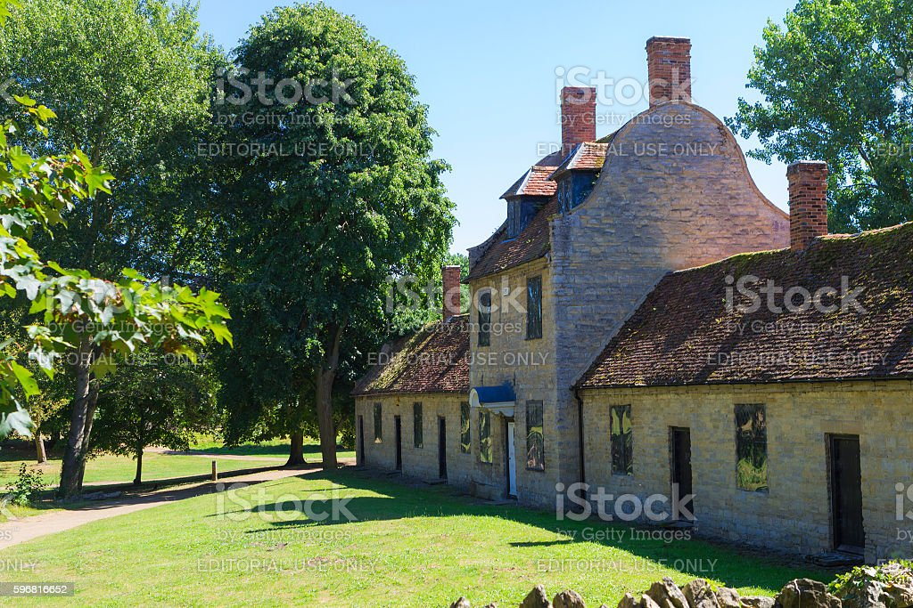 Great Linford manor complex under blue sky stock photo