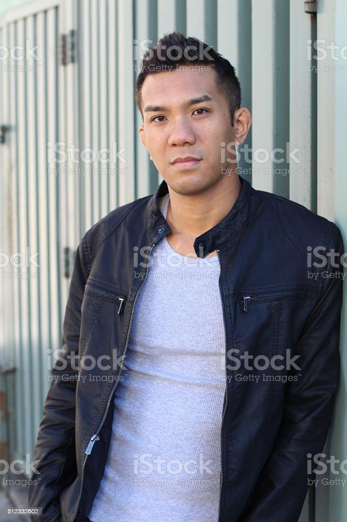 Great looking tough asian guy stock photo