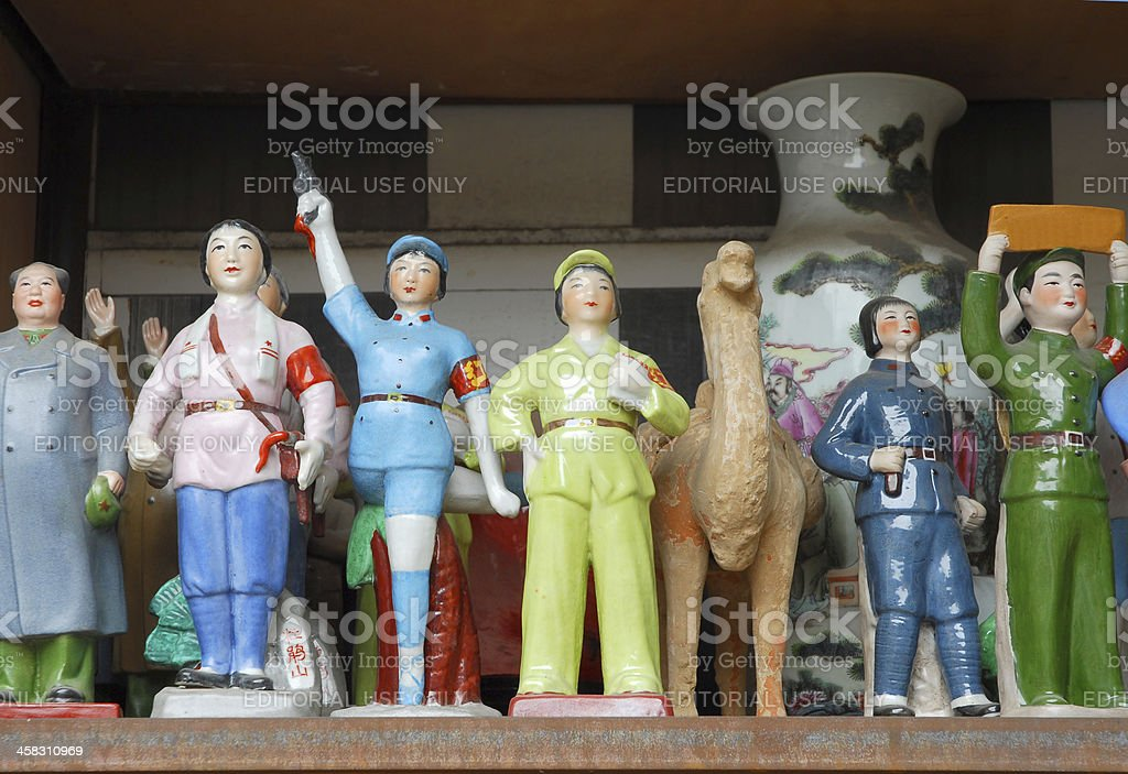 Great Mao and simple people statues on sale stock photo
