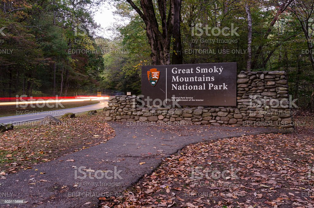Great Smoky Mountains Entry Sign with Car Lights stock photo