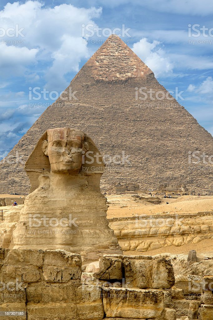 Great Sphinx of Giza against the Great Pyramid, Giza, Egypt stock photo