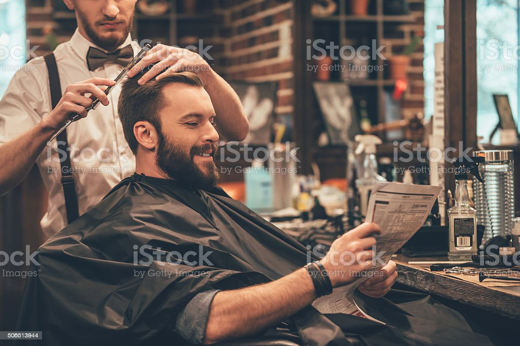 Great time at barbershop. stock photo