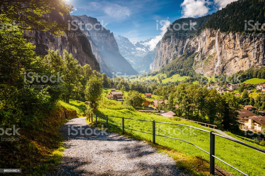 Great view of alpine village glowing by sunlight. stock photo