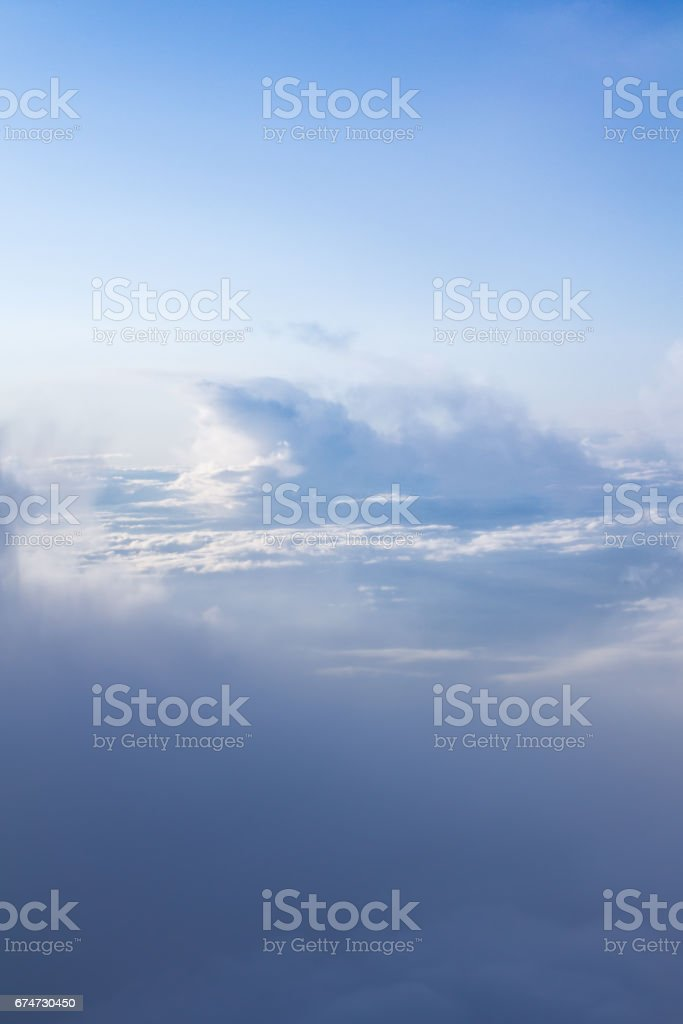 Great view over the clouds with awesome light. stock photo