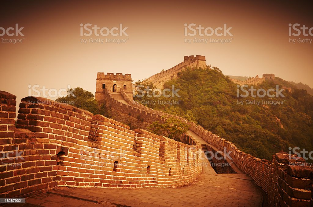 Great Wall of China during sunrise stock photo