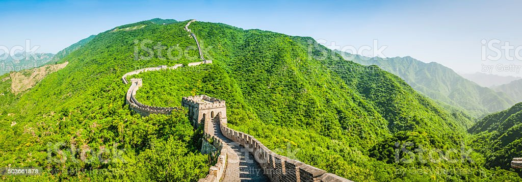 Great Wall of China iconic battlements curving over green hills stock photo