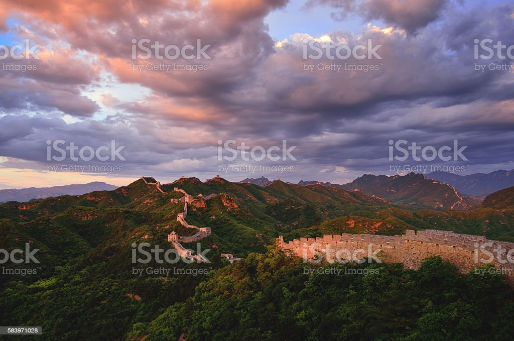 Great wall of China in dramatic sky at sunset stock photo
