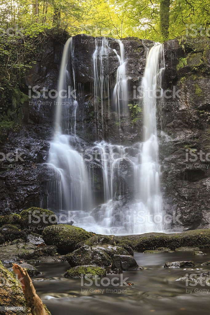 Great waterfall in forest stock photo