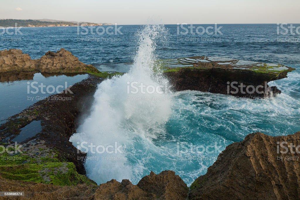 Great waves at Devil's Tear on Nusa Lembongan Sunset stock photo