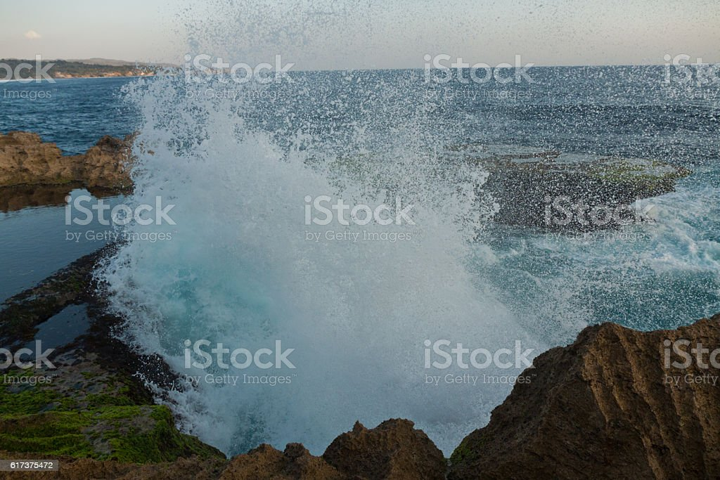 Great waves at Devil's Tear on Nusa Lembongan Sunset stock photo