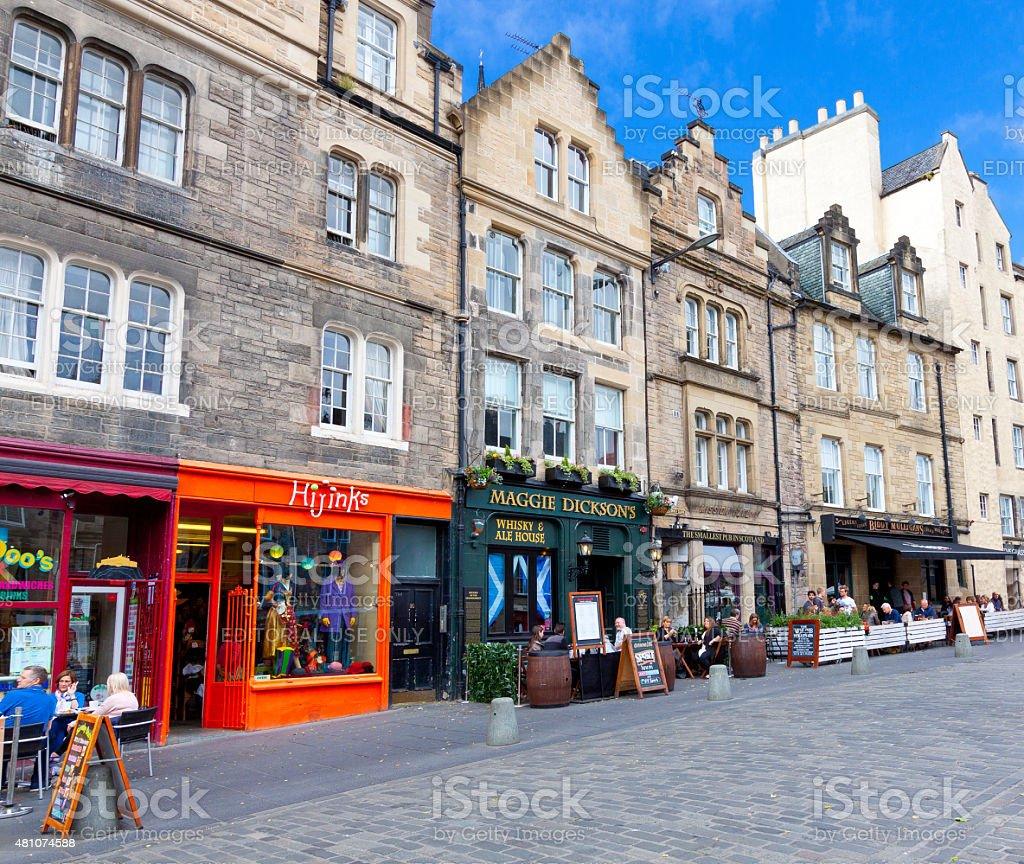 Greater Grassmarket lined with restaraunts and pubs, Edinburgh, United Kingdom. stock photo