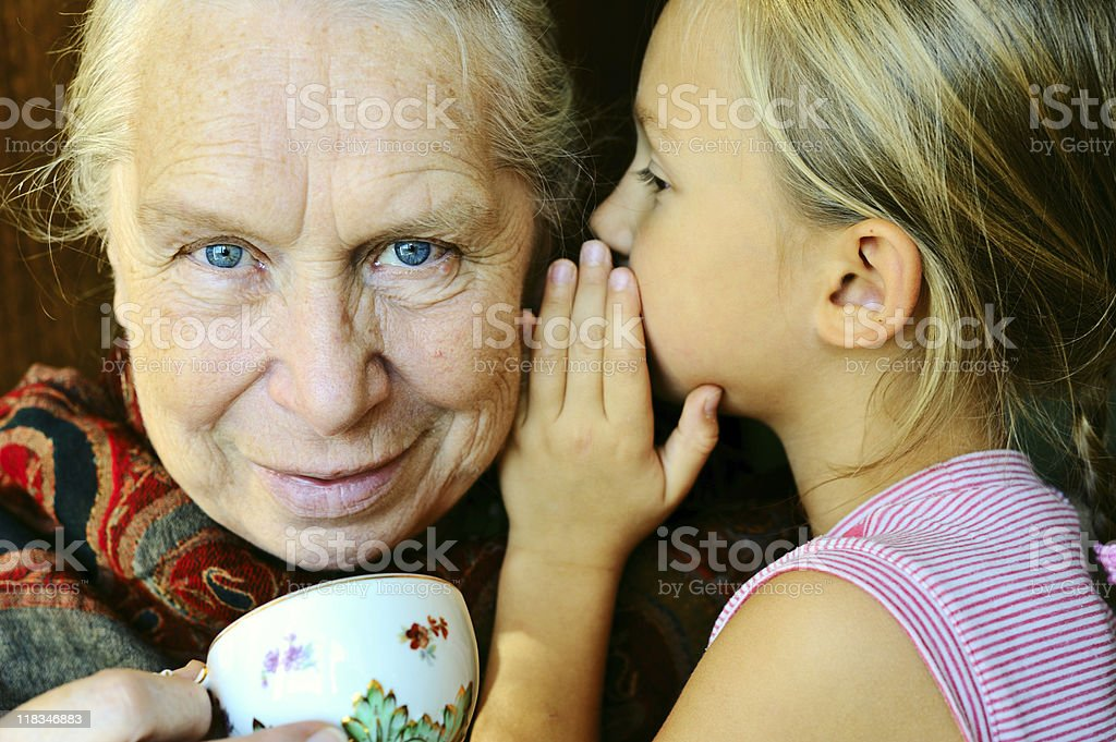 Great-grandmother and her little great-granddaughter royalty-free stock photo