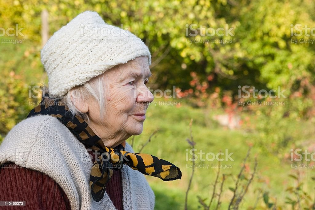 Great-grandmother in the garden stock photo